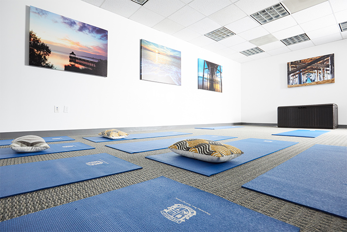 Yoga Room with Mats and Pillows | Newport Healthcare